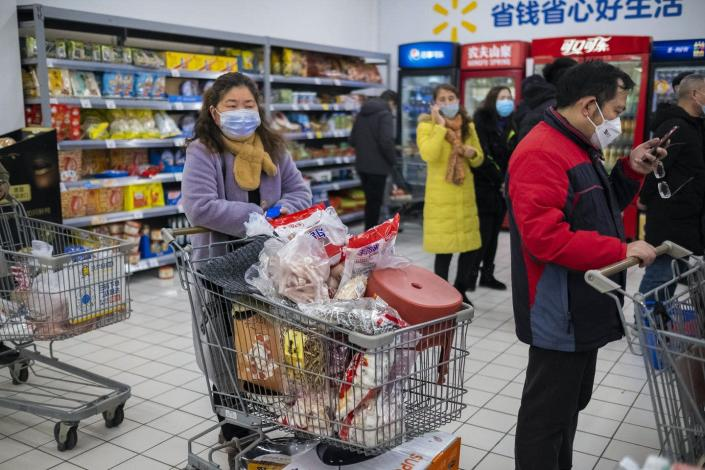 """<span class=""""caption"""">Shoppers in face masks as they line up at a grocery store in Wuhan, a city of 11 million, in central China's Hubei Province. The urbanization of once densely forested areas of Asia and Africa have contributed to the spread of these deadly viruses.</span> <span class=""""attribution""""><a class=""""link rapid-noclick-resp"""" href=""""http://www.apimages.com/metadata/Index/China-Outbreak-Leaving-Wuhan/8cc09d14dcc744f4b227285527d13ae9/14/0"""" rel=""""nofollow noopener"""" target=""""_blank"""" data-ylk=""""slk:AP Photo / Arek Rataj"""">AP Photo / Arek Rataj</a></span>"""