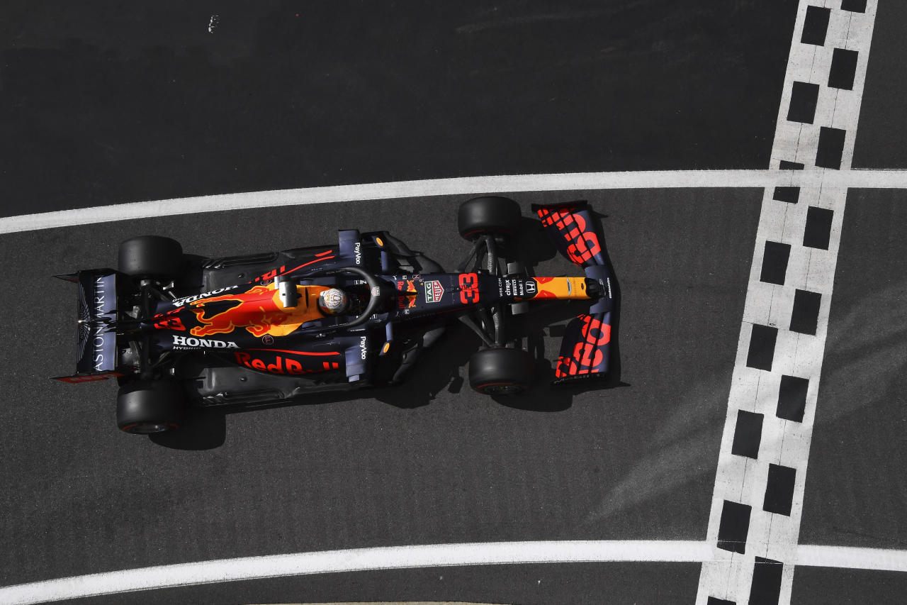 Red Bull driver Max Verstappen of the Netherlands enters the pit lane after he clocked the third fastest time during the qualifying session for the British Formula One Grand Prix at the Silverstone racetrack, Silverstone, England, Saturday, Aug. 1, 2020. The British Formula One Grand Prix will be held on Sunday. (Ben Stansall/Pool via AP)