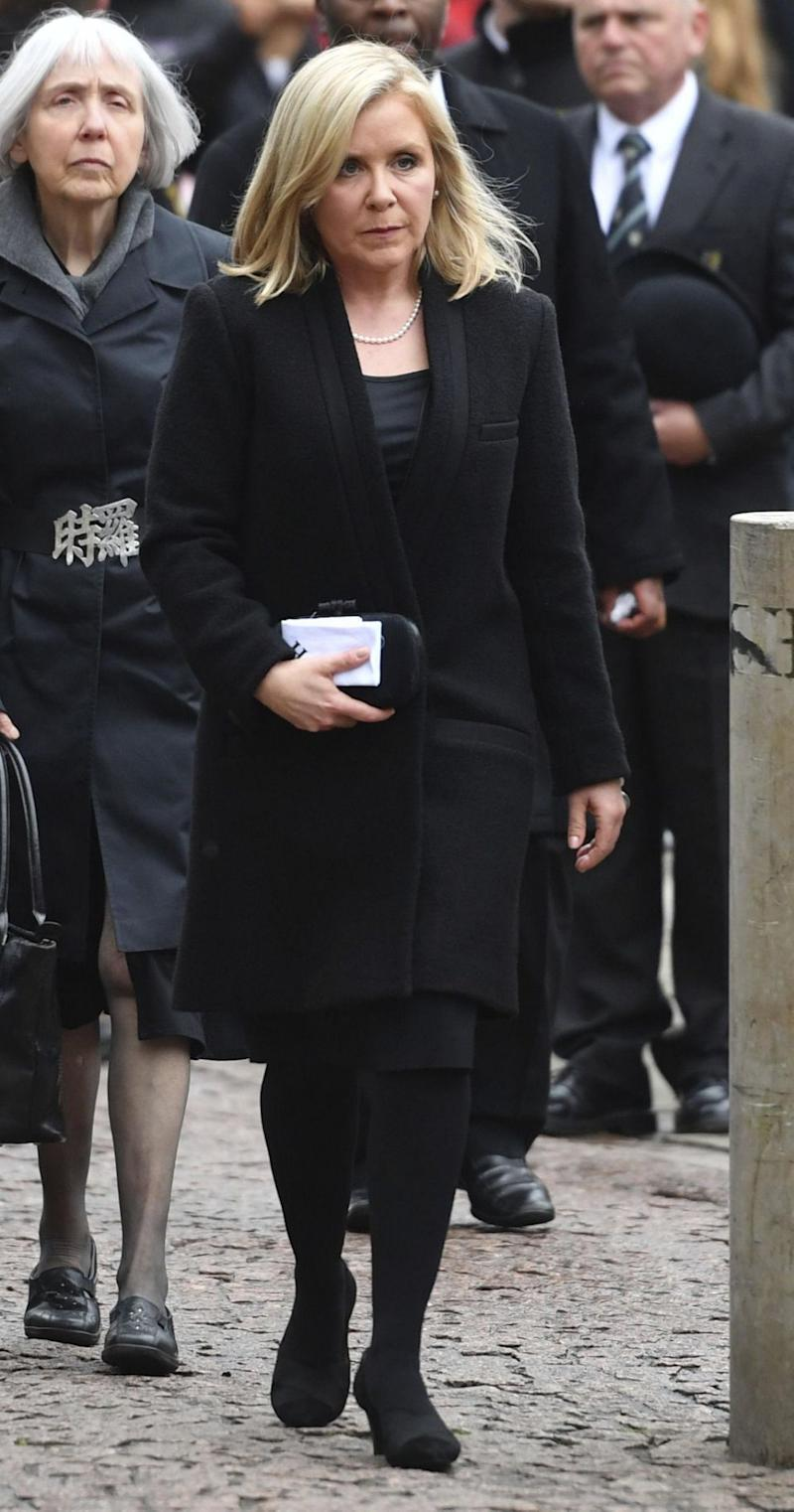 His daughter, Lucy, was also pictured on her way into the funeral service. Photo: AAP