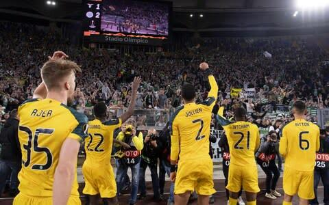 <span>Celtic players celebrate their victory over Lazio with their supporters </span> <span>Credit: REX </span>