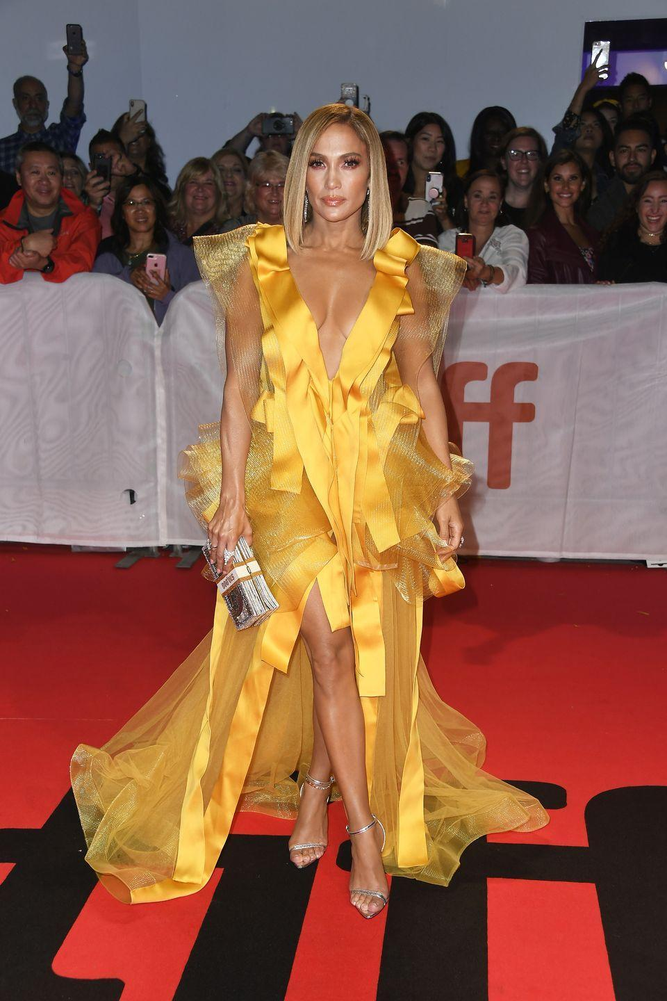 <p>She shows TF up to the Toronto Internal Film Festival in a marigold Maison Yeya gown with a dramatically low neckline. </p>