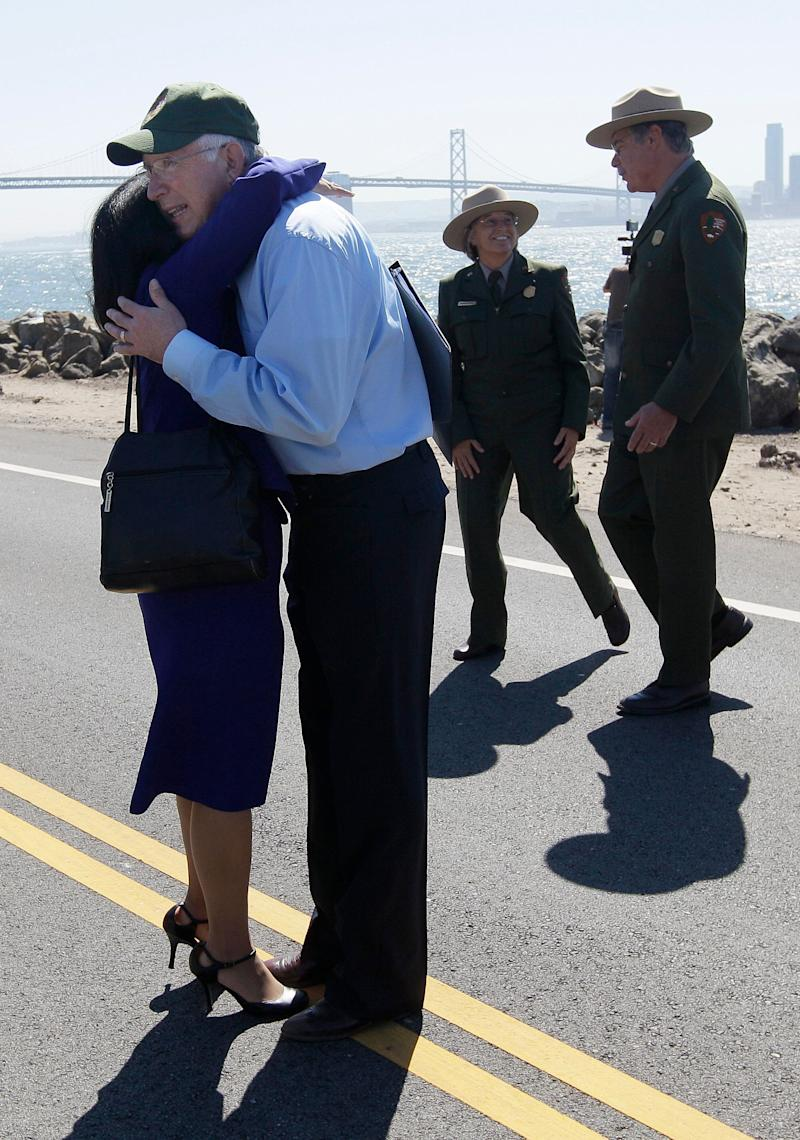 U.S. Secretary of the Interior Ken Salazar, foreground right, hugs Assistant Attorney General Ignacia S. Moreno after a news conference in Treasure Island, Calif., Monday, Sept. 19, 2011. The companies responsible for the 2007 oil spill in San Francisco Bay have agreed to pay the government $44.4 million for the cleanup costs. Salazar, California Attorney General Kamala Harris and other officials announced the proposed deal Monday. It would settle several lawsuits filed against Hong Kong-based Fleet Management Ltd. and Regal Stone Ltd. (AP Photo/Jeff Chiu)