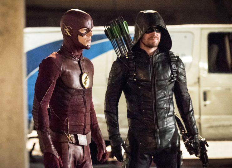 Grant Gustin as The Flash and Stephen Amell as Green Arrow (Credit: The CW)