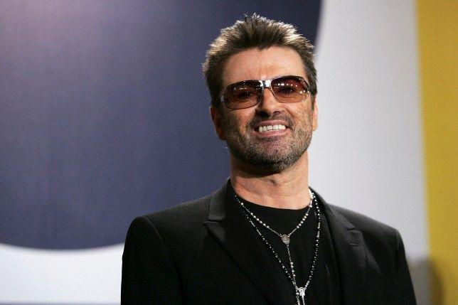 George Michael stuns in all black outfit with a rose chain on his neck