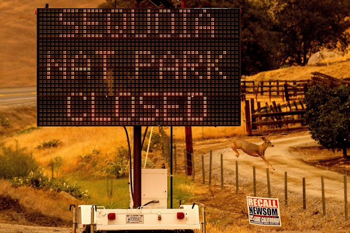 A sign announces the closure of Sequoia National Park, where the KNP Complex Fires are burning, Tuesday, Sept. 14, 2021, in Tulare County, Calif. Individually named the Colony and Paradise Fires, the blazes are burning near the Giant Forest, home to more than 2,000 giant sequoias.