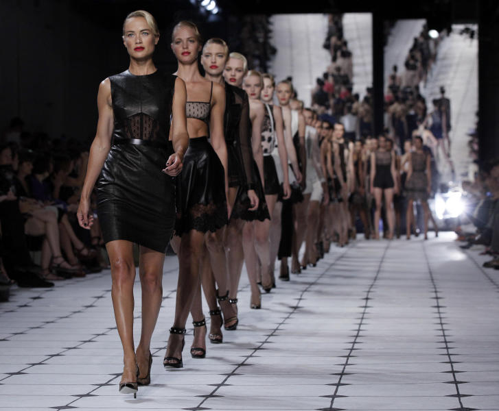 Models, led by Carolyn Murphy, walk in the finale of the Jason Wu Spring 2013 collection during Fashion Week in New York, Friday, Sept. 7, 2012. (AP Photo/Richard Drew)