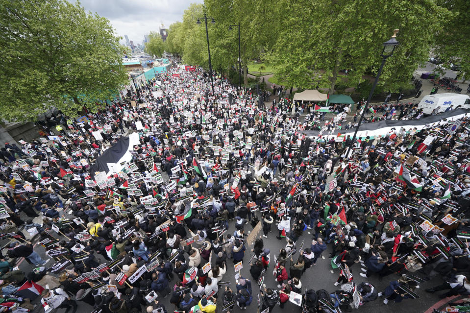 Protesters gather in central London, Saturday May 22, 2021, and take part in a rally in support of Palestinians. Egyptian mediators held talks Saturday to firm up an Israel-Hamas cease-fire as Palestinians in the Hamas-ruled Gaza Strip began to assess the damage from 11 days of intense Israeli bombardment. (Yui Mok/PA via AP)