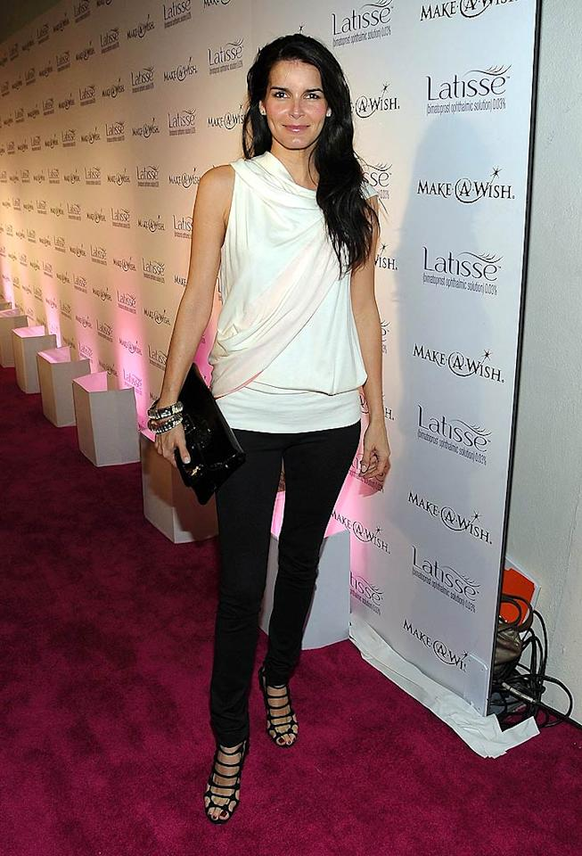 "You'd never guess that Angie Harmon gave birth to her third child in December 2008! Jordan Strauss/<a href=""http://www.wireimage.com"" target=""new"">WireImage.com</a> - March 26, 2009"