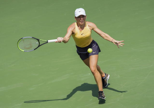 Simona Halep is a Romania returns a shot to Jennifer Brady of the US during round 2 of the Rogers Cup Women's tennis tournament in Toronto, Wednesday, Aug. 7, 2019. (Mark Blinch/The Canadian Press via AP)