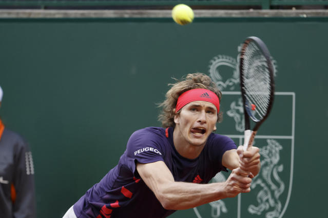 Alexander Zverev, of Germany returns a ball to Ernests Gulbis of Latvia during their second round match at the ATP 250 Geneva Open tournament in Geneva, Switzerland, Tuesday, May 21, 2019. (Salvatore Di Nolfi/Keystone via AP)