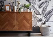 """<p>This tend taps into strong geometry, graphic shapes and clean lines. We love the herringbone effect on this <a href=""""https://www.homebase.co.uk/skelby-herringbone-oak-sideboard_p568962"""" rel=""""nofollow noopener"""" target=""""_blank"""" data-ylk=""""slk:Skelby White Oak Sideboard"""" class=""""link rapid-noclick-resp"""">Skelby White Oak Sideboard</a> (£250), and we're rather fond of the <a href=""""https://www.homebase.co.uk/grandeco-life-digital-mural-paysage-black-white_p568647"""" rel=""""nofollow noopener"""" target=""""_blank"""" data-ylk=""""slk:Grandeco Life Digital Mural, Paysage in Black and White"""" class=""""link rapid-noclick-resp"""">Grandeco Life Digital Mural, Paysage in Black and White</a>, too – transform one wall for just £45.<br></p>"""