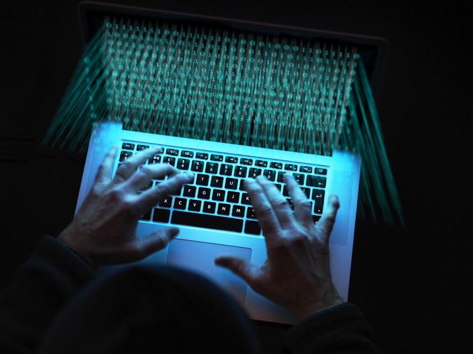 Cyber crime, A hacker using a virus to attack software. Photo: Getty