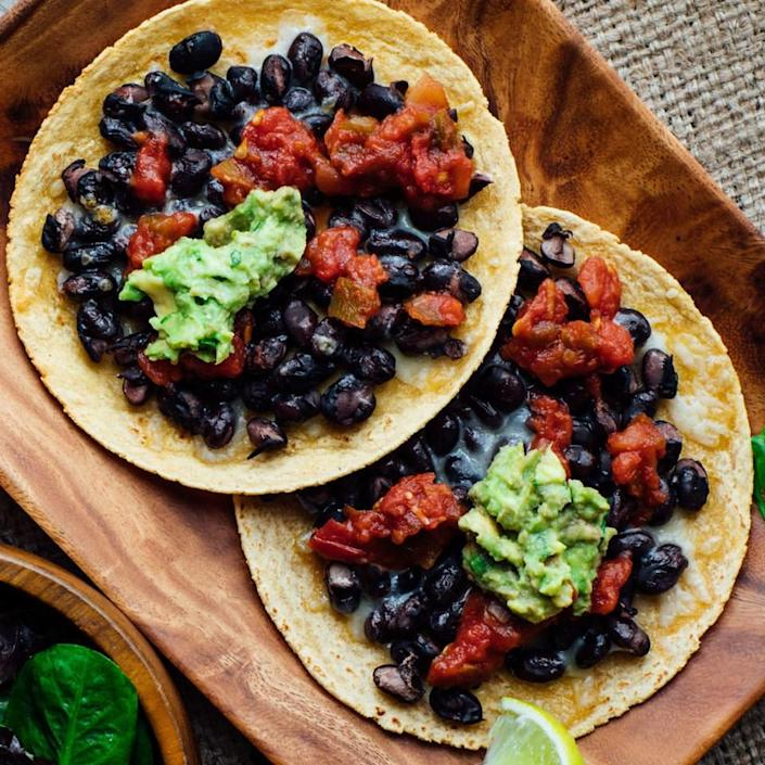 <p>Would you believe us if we said you can have restaurant-style tostadas at home in just 15 minutes? It's no problem! Simply layer black beans and Cheddar onto corn tortillas and toast in the toaster oven.</p>