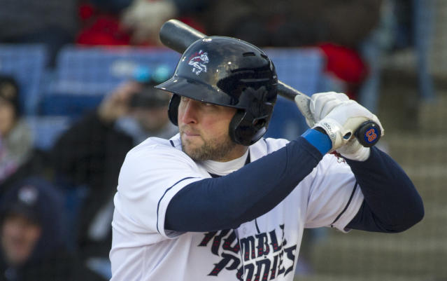 Tim Tebow, playing for the Binghamton Ruble Ponies, prepares to bat in the first inning of his debut with the team, against the Portland Sea Dogs in a Double-A baseball game Thursday, April 5, 2018, in Binghamton, N.Y. (AP Photo/Matt Smith)