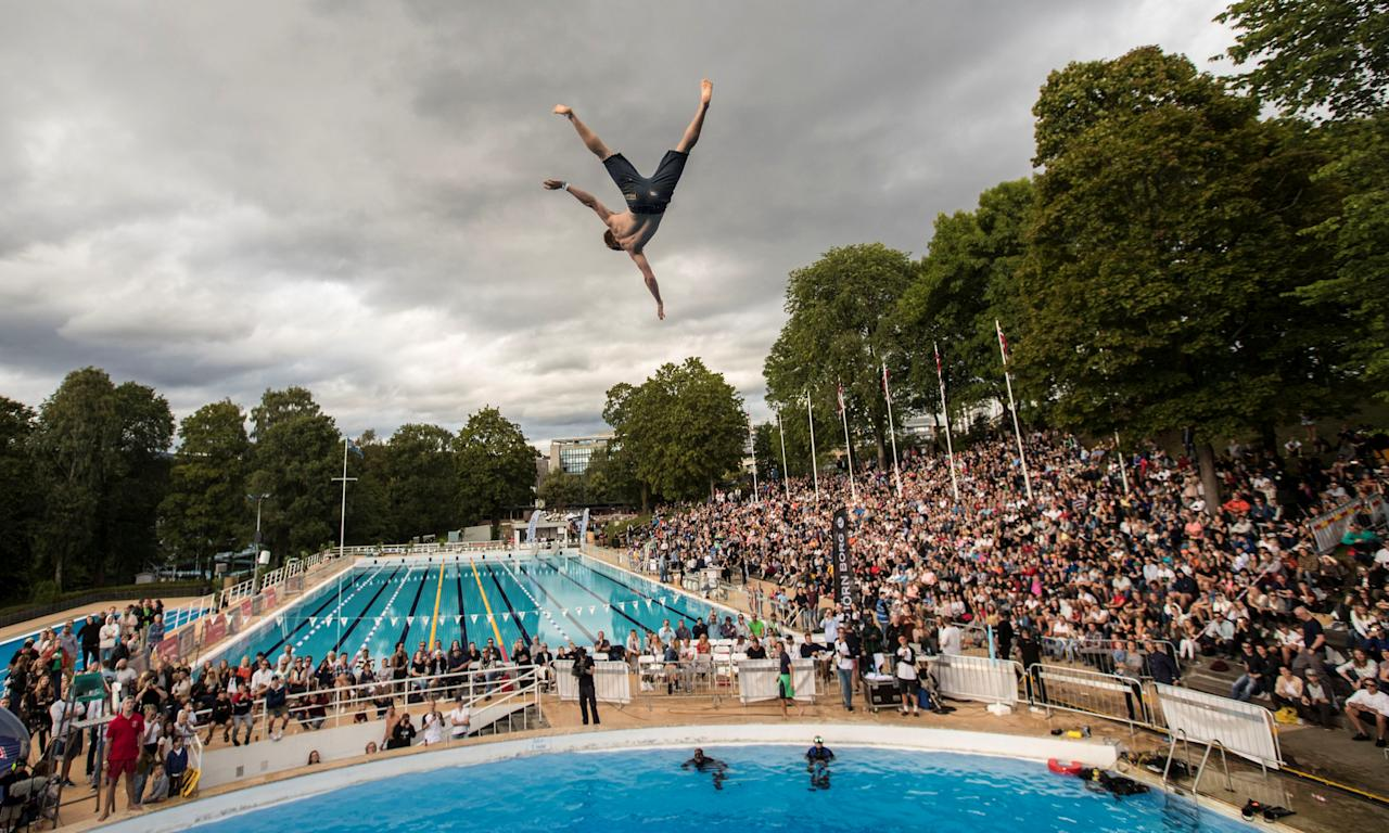 A competitor in the air during the World Championships in belly-flopping at Frognerbadet in Oslo, Norway August 19, 2017. NTB scanpix/Vidar Ruud/via REUTERS    ATTENTION EDITORS - THIS IMAGE WAS PROVIDED BY A THIRD PARTY. NORWAY OUT. NO COMMERCIAL OR EDITORIAL SALES IN NORWAY. NO COMMERCIAL SALES.