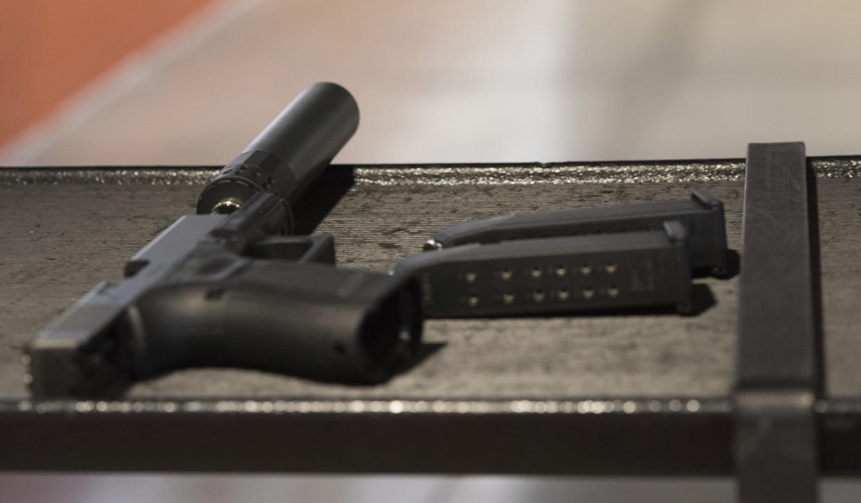 In this photo taken Jan. 27, 2017, a handgun with a silencer and two magazines are shown at a gun range in Atlanta. (Photo: Lisa Marie Pane/AP)