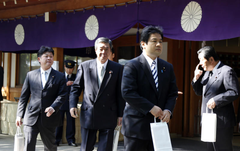 Japanese lawmakers leave after their visit to the Yasukuni Shrine in Tokyo during an annual spring festival on Tuesday, April 23, 2013. Marking the spring festival, 168 lawmakers paid homage to the controversial war shrine. (AP Photo/Koji Sasahara)