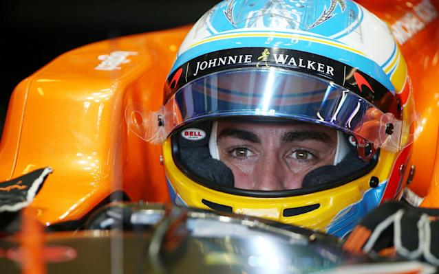 Fernando Alonso knows he faces an uphill task once again this season in the McLaren-Honda - AP
