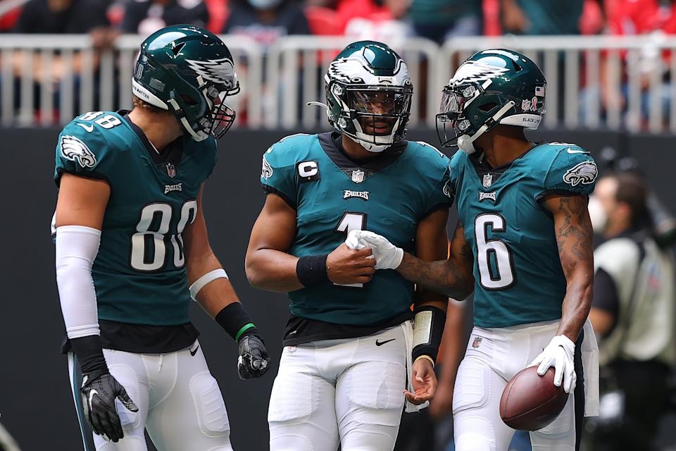 ATLANTA, GEORGIA - SEPTEMBER 12: DeVonta Smith #6 of the Philadelphia Eagles celebrates with Jalen Hurts #1 after catching a 18-yard pass for a touchdown during the first quarter against the Atlanta Falcons at Mercedes-Benz Stadium on September 12, 2021 in Atlanta, Georgia. (Photo by Kevin C. Cox/Getty Images)