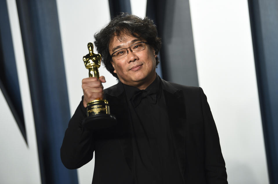 """Bong Joon-ho, winner of the awards for best original screenplay, best international feature film, best directing, and best picture for """"Parasite,"""" arrives at the Vanity Fair Oscar Party on Sunday, Feb. 9, 2020, in Beverly Hills, Calif. (Photo by Evan Agostini/Invision/AP)"""