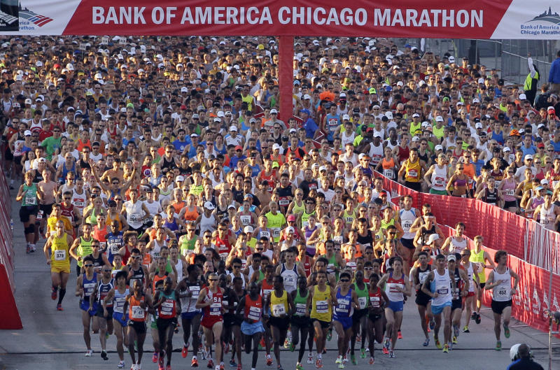 FILE - In this Oct. 9, 2011 file photo, Runners start the Chicago Marathon in Chicago. Police aren't talking about all the security measures they are taking for Sunday Oct. 13, 2013, Chicago Marathon, but they leave little doubt that the first so-called World Marathon Major in the United States since the Boston Marathon bombings last April will be the most closely watched race in the city's history. (AP Photo/Nam Y. Huh, File)
