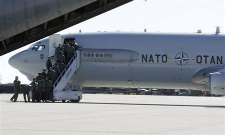 Airmen board a NATO AWACS (Airborne Warning and Control Systems) aircraf during a joint NATO military exercise in Siauliai April 1, 2014. The NATO alliance said it will start reconnaissance flights with AWACS planes from their home base in Geilenkirchen and Waddington in Britain over Poland and Romania to monitor the situation in neighbouring Ukraine where Russian forces have taken control of Crimea. REUTERS/Ints Kalnins