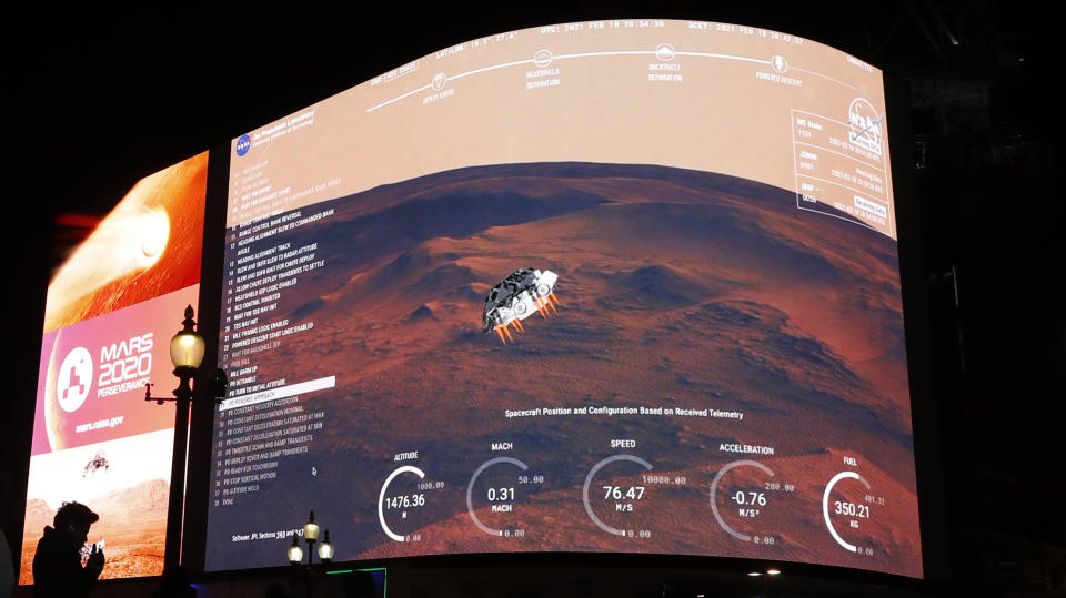 Images from NASA seen streamed live showing the landing of Perseverance on Mars, on Piccadilly Lights in central London. Source: AP