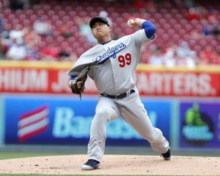 May 19, 2019; Cincinnati, OH, USA; Los Angeles Dodgers starting pitcher Hyun-Jin Ryu (99) throws against the Cincinnati Reds during the first inning at Great American Ball Park. Mandatory Credit: David Kohl-USA TODAY Sports