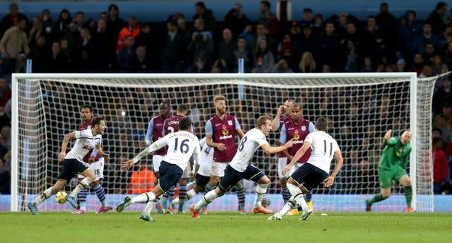 Harry Kane, centre, celebrates after finally scoring his first goal of the 2014-15 season
