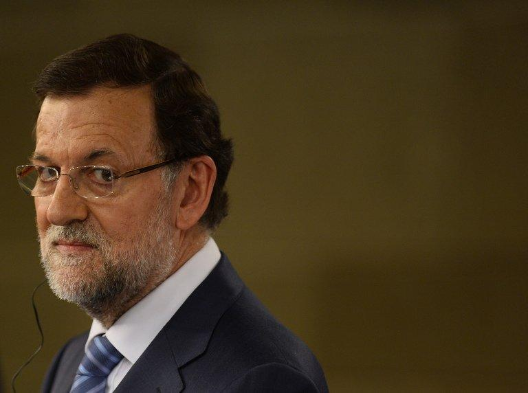 Spanish Prime Minister Mariano Rajoy looks on during a press conference in Madrid, on July 22, 2013