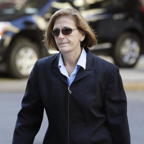 FILE - In this Oct. 8, 2013 file photo, JoAnn Crupi, former account manager for imprisoned financier Bernard Madoff, arrives to federal court in New York. Crupi and four other back-office subordinates of Madoff are accused of aiding the disgraced financier in one of history's biggest frauds. Opening statements by defense lawyers are slated to begin Thursday, Oct. 17, 2013. (AP Photo/Seth Wenig, File)