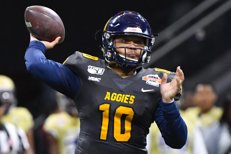 North Carolina A&T quarterback Kylil Carter (10) passes during first half of the Celebration Bowl NCAA college football game against Alcorn State, Saturday, Dec. 21, 2019, in Atlanta. (John Amis/Atlanta Journal-Constitution via AP)