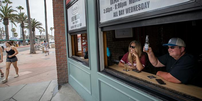 Main Street in Huntington Beach, California, on July 1. Bars across Orange County, many of which have only recently reopened, will be forced to shut down again beginning at midnight Thursday, officials announced.