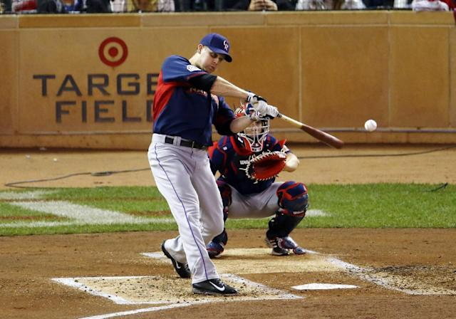 National League's Justin Morneau, of the Colorado Rockies, hits during the MLB All-Star baseball Home Run Derby, Monday, July 14, 2014, in Minneapolis. (AP Photo/Paul Sancya)