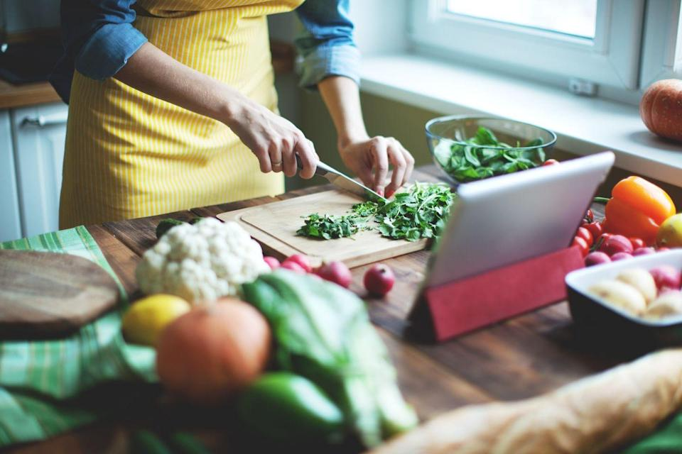 "<p>Select a recipe that correlates with the <a href=""https://www.marieclaire.com/culture/g31926591/best-cooking-shows-netflix/"" rel=""nofollow noopener"" target=""_blank"" data-ylk=""slk:cooking skills"" class=""link rapid-noclick-resp"">cooking skills</a> you both have and get ready to enjoy a tasty meal at home. Grab what you need at the grocery store, get on that Zoom call, and get moving. For some added fun, make your version of Food Network's <em>Chopped</em> and see who can make the best-looking dish from the ingredients they have at home. (You might not get to taste, so you'll have to take their word for it...)</p>"