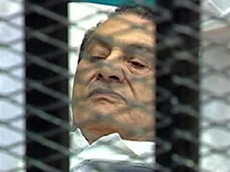 Former Egyptian President Hosni Mubarak is seen in the courtroom for his trial at the Police Academy in Cairo, in this still image taken from video August 3, 2011. REUTERS/Egypt TV via Reuters TV
