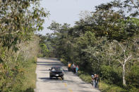 Migrants trek on the highway from Frontera Corozal to Palenque, Chiapas state, Mexico, Wednesday, March 24, 2021. (AP Photo/Eduardo Verdugo)