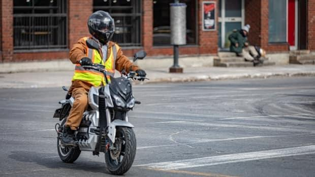 A person rides a motorcycle in downtown Ottawa on March 16. (Brian Morris/CBC - image credit)