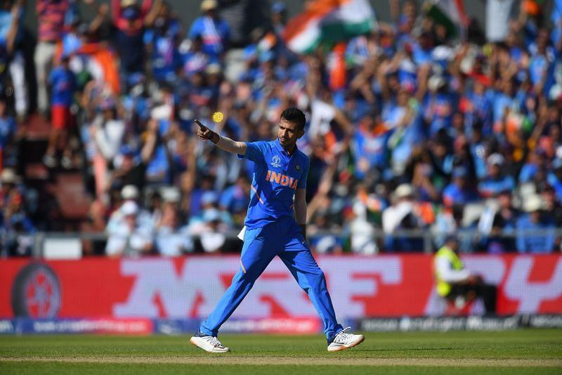 Yuzvendra Chahal reacts after picking up a wicket.