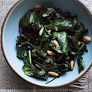 """<p><a href=""""https://www.myrecipes.com/ingredients/spinach-recipes"""" rel=""""nofollow noopener"""" target=""""_blank"""" data-ylk=""""slk:Spinach"""" class=""""link rapid-noclick-resp"""">Spinach</a> is sauteed with shallots and sprinkled with toasted pine nuts. This side dish is easy and ready in no time.</p>"""