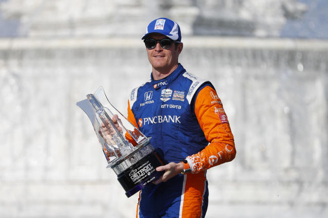Scott Dixon, of New Zealand, celebrates after winning the second race of the IndyCar Detroit Grand Prix auto racing doubleheader in Detroit, Sunday, June 2, 2019. (AP Photo/Paul Sancya)