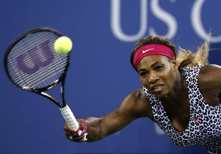 Williams of the U.S. returns a shot to compatriot Townsend during their women's singles match at the U.S. Open tennis tournament in New York