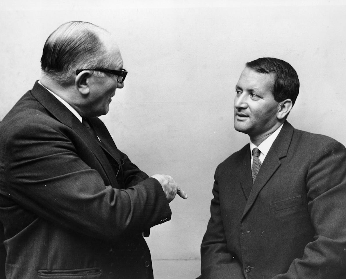 Journalist Walter Bartleman talks to cricketer Basil D'Oliveira.    (Photo by Evening Standard/Getty Images)