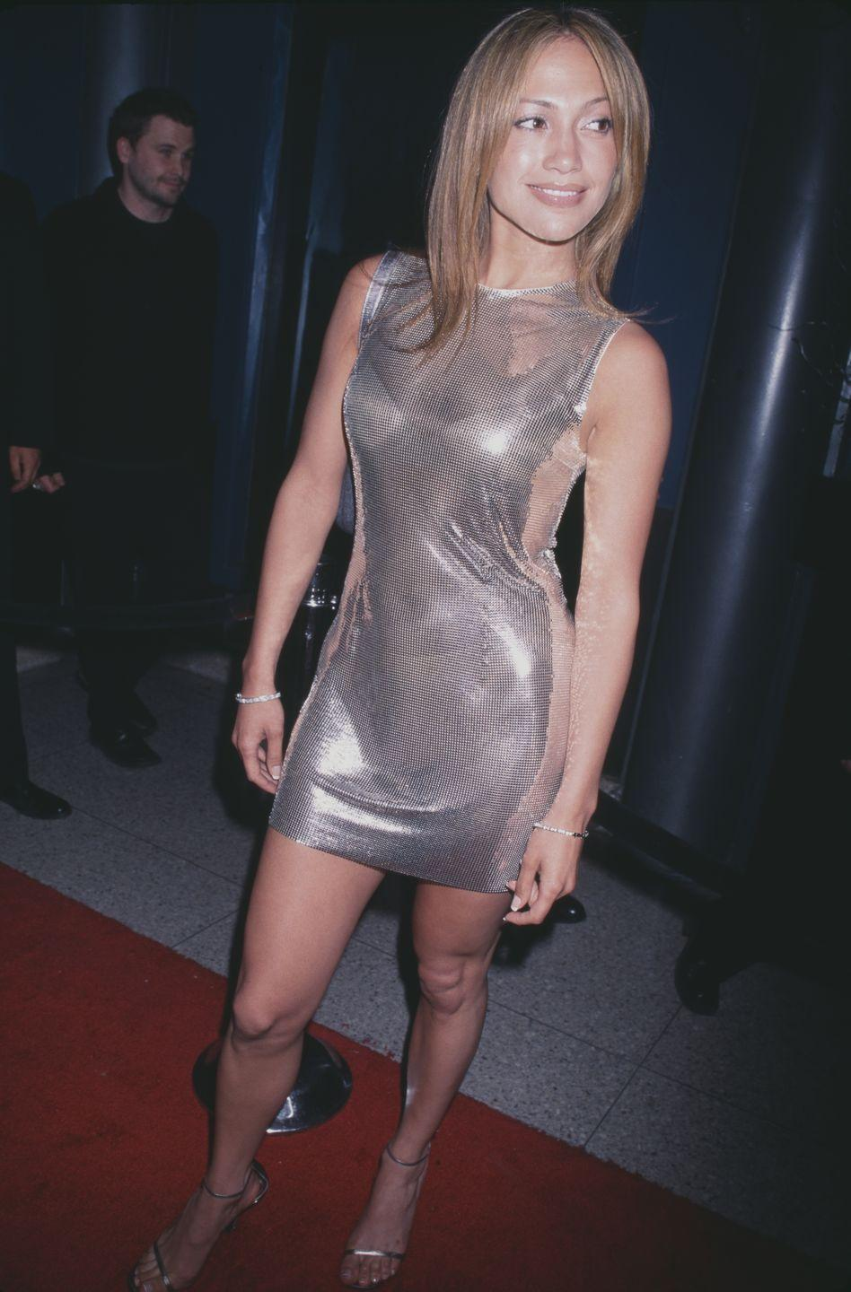 <p>In a Versace sheer glitter mini dress - starting a J.Lo trend that would last decades.</p>
