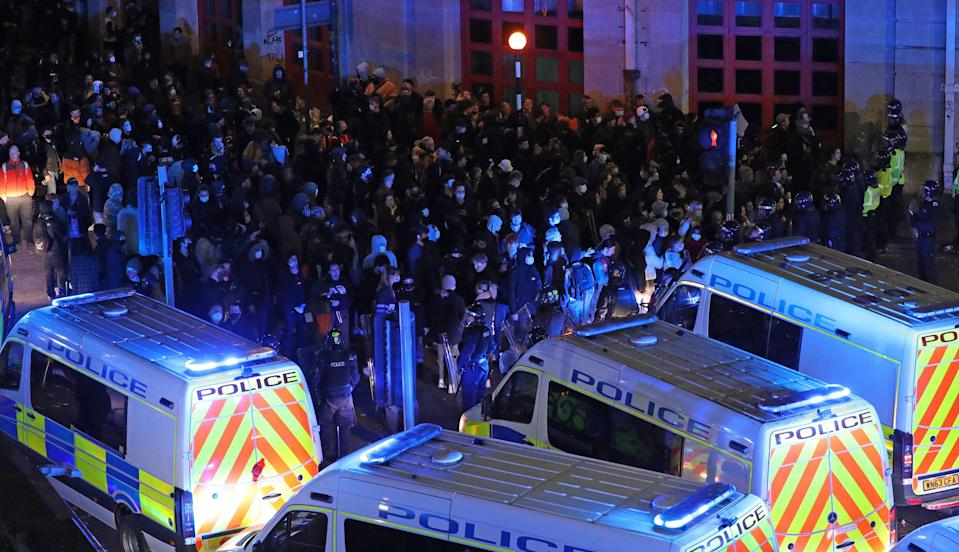 <p>Riot police move down Rupert Street in Bristol towards protesters</p> (PA Wire)