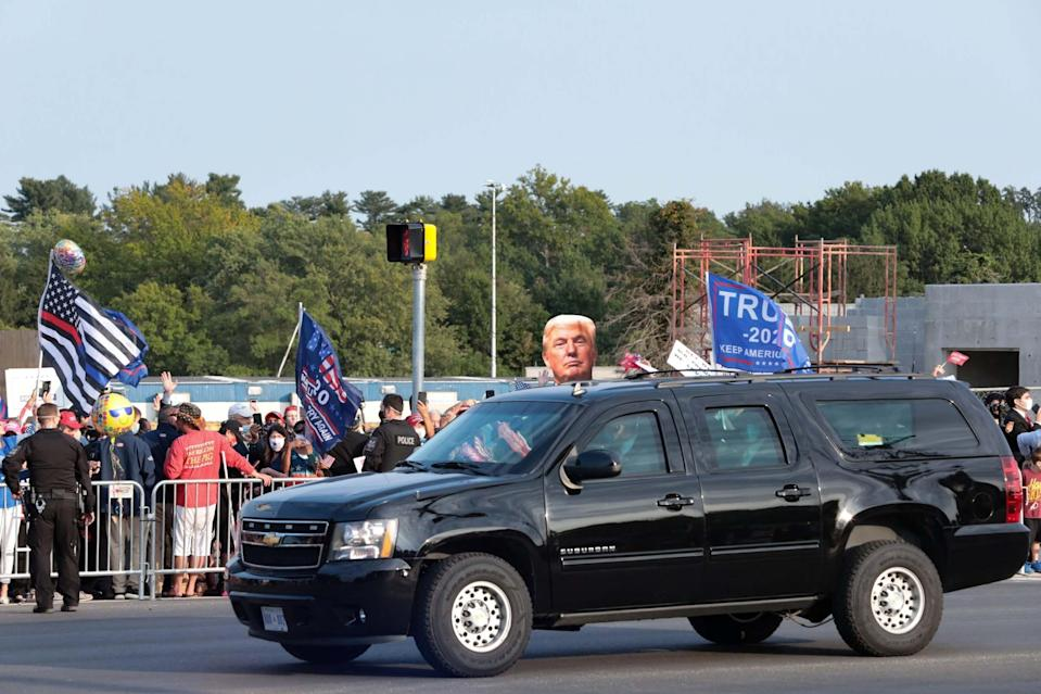 The president greeted supporters from his car on Sunday (REUTERS)