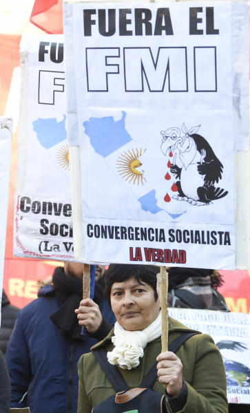 "A protester holds a sign that reads in Spanish "" Get out IMF "" regarding the International Monetary Fund, during demonstration against International Monetary Fund near the G20 Finance Minister and Central Bank governors meeting in Buenos Aires, Argentina, Saturday, July 21, 2018. (AP Photo/Gustavo Garello)"