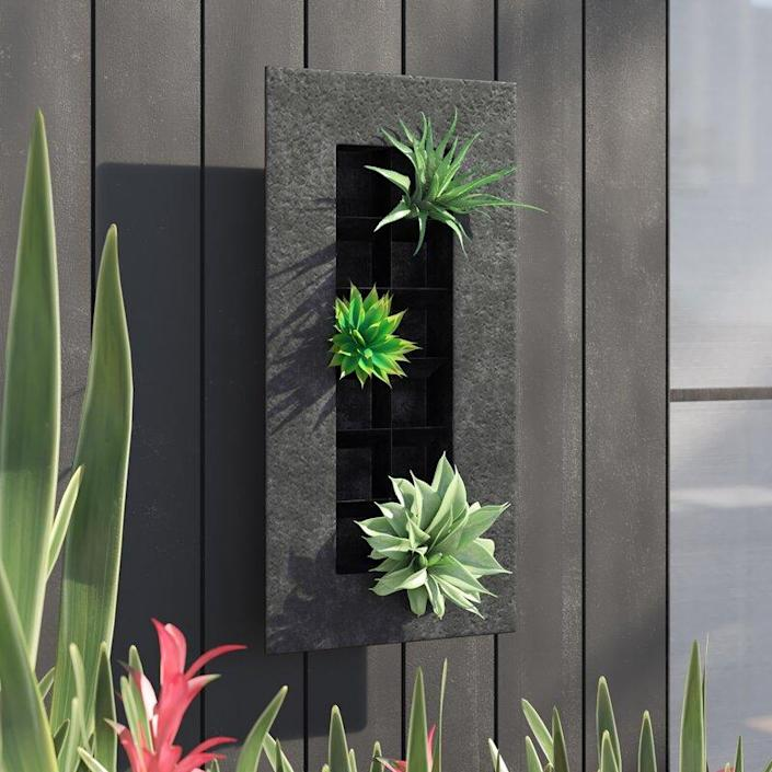 "You can add up to 12 succulents or plants in this oversized, weather-resistant, rust-resistant planter that will bring new life to your outdoor space. $49, AllModern. <a href=""https://www.allmodern.com/--Zinc-12-Pocket-Metal-Wall-Planter-47M133-47M134-L349-K~JOZ5134.html"" rel=""nofollow noopener"" target=""_blank"" data-ylk=""slk:Get it now!"" class=""link rapid-noclick-resp"">Get it now!</a>"