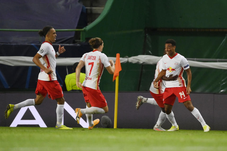 Tyler Adams (right) celebrates with teammates after scoring the goal that sent RB Leipzig to the UEFA Champions League semifinals. (Lluis Gene/Getty Images)