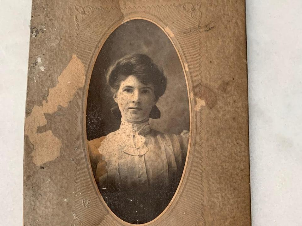 This old sepia portrait of a woman wearing a high-collar, ruffled blouse was found during renovations of a north-end Halifax home. The identity of the woman is a mystery.  (Submitted by Sarah Warford - image credit)